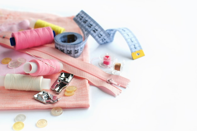 Sewing accessories and fabric on a white background