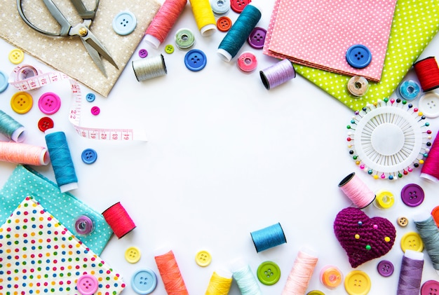 Sewing accessories on a white background