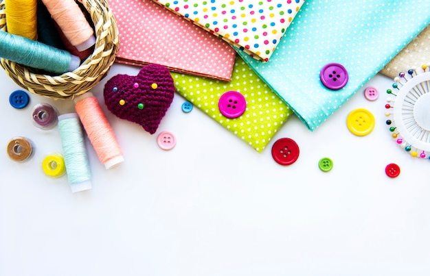 Sewing accessories on white