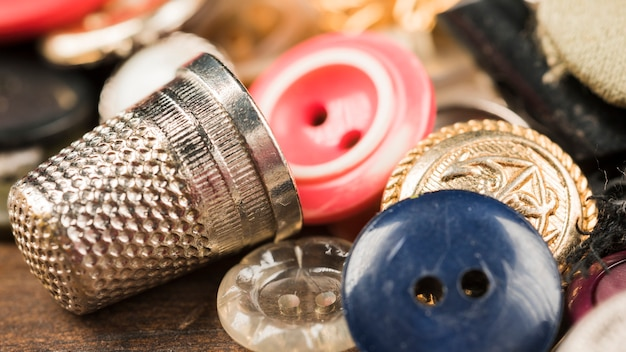 Sewing buttons with thimble