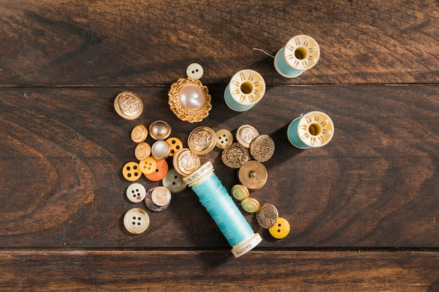 Sewing buttons with thread reel
