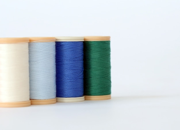 Sewing. colorful threads on a white background