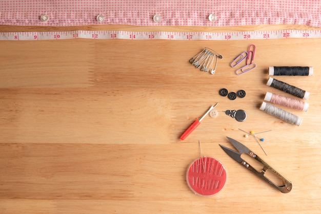 Sewing equipment placed on rough wood