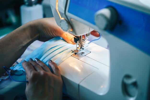 Sewing face masks at home.