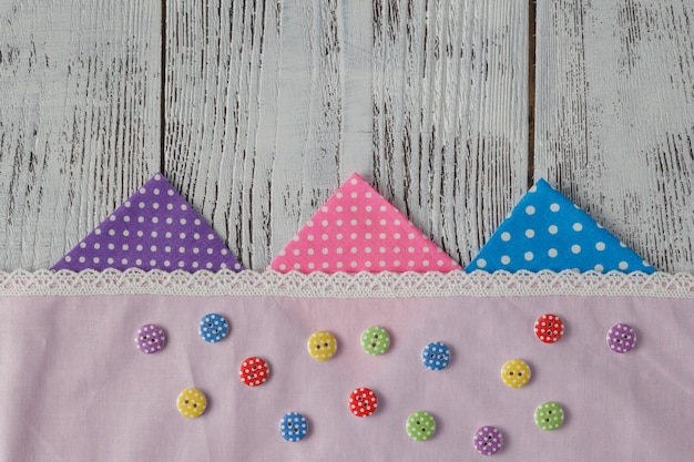 Sewing, knitting and crochet accessories. fabric, wooden table. copy space