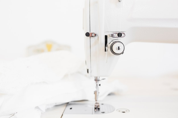 Sewing machine and cloth on designer work desktop