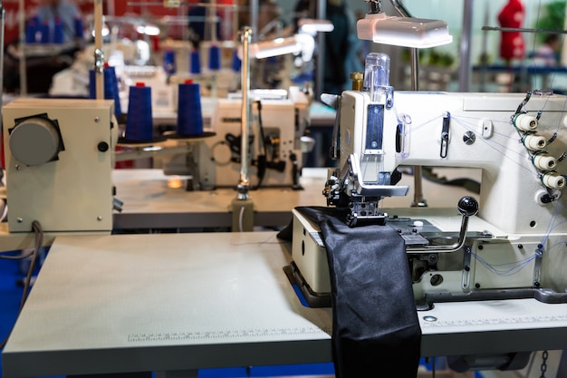 Sewing machine in cutting shop on leather cloth factory, nobody. fabric production, sew manufacturing, needlework technology