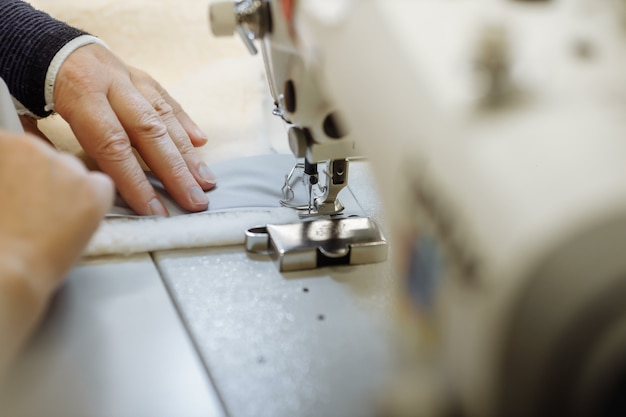 Sewing machine scribbling fabric. tailoring at the factory.