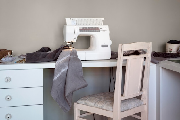 Sewing machine in a tailor workplace