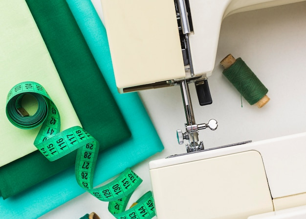 Sewing machine with thread and measuring tape