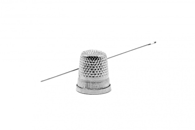 Sewing needle with metal thimble
