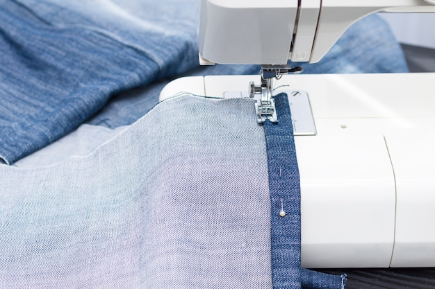 Sewing and needlework at home. jeans recycling.