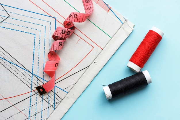 Sewing pattern, threads on a blue background,