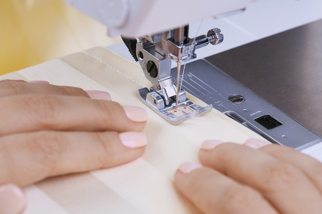 The sewing process, on an electric sewing machine. household.