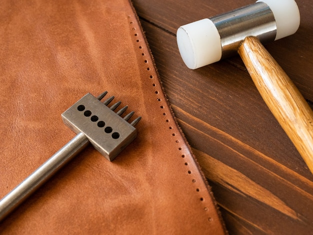 Sewing a purse, wallet, bag, backpack. tool for working with genuine leather.