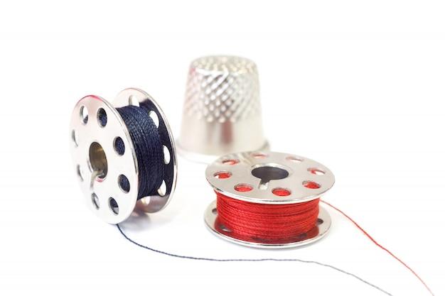 Sewing spools and thimble. macro.