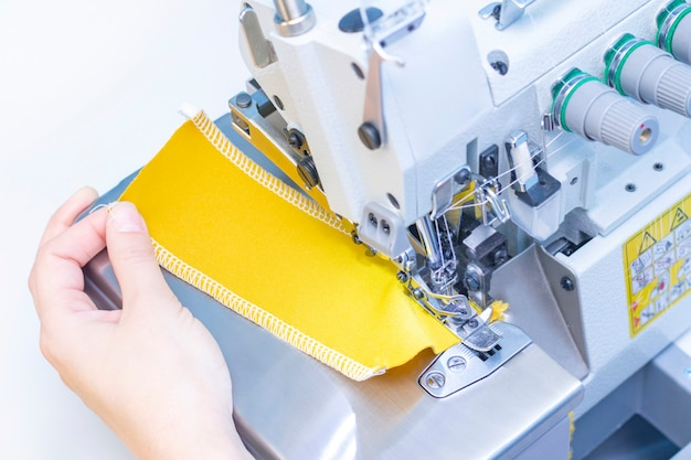 Sewing studio. seamstress patch fabric. overlock stitch. overlock for sewing fabric. tailoring