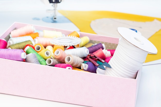Sewing studio. sewing machine. a set of items for needlework: threads, needles, pins, tape measure, etc.