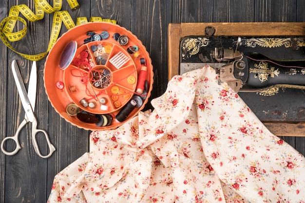 Sewing supplies and flowery pattern