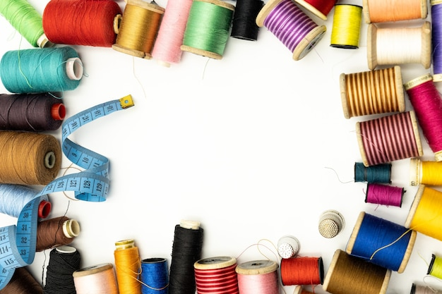 Sewing supplies kit around a large blank , view from above