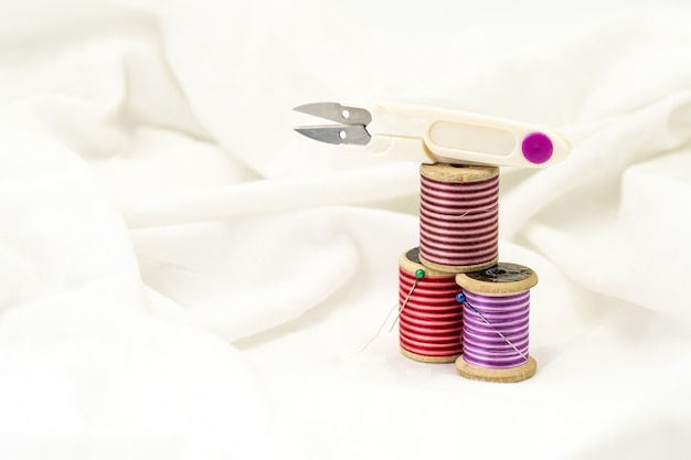 Sewing supplies kit on a white fabric