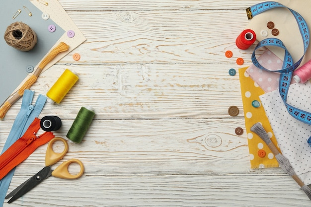 Sewing supplies on white