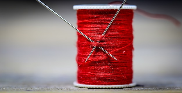 Sewing thread red needles