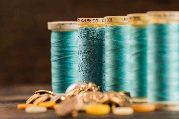 Sewing thread reels with buttons
