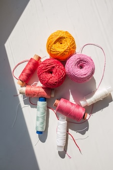 Sewing threads on white background