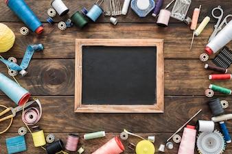 Sewing tools around blackboard