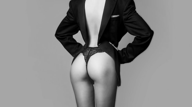 섹시한 엉덩이, 관능적인 여성의 몸. 팬티에 여성 엉덩이입니다. 재단사, 재단사. 남자 정장. 우아한 여성복. 럭셔리 남성 클래식 슈트. 여자 엉덩이. 비키니 속옷. 큰 섹시한 엉덩이.