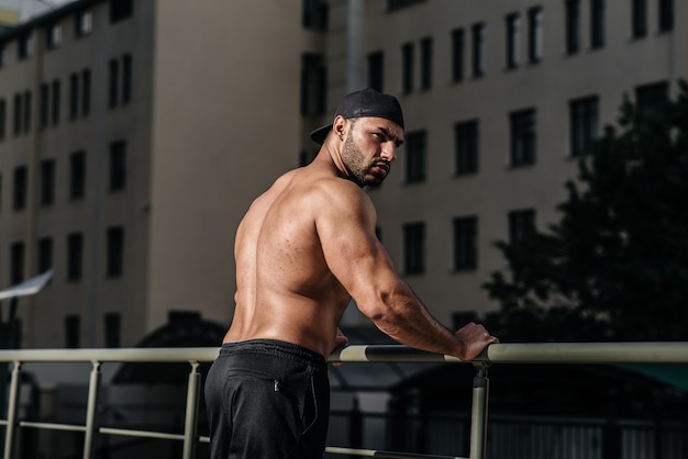 Sexy athlete sucks and poses topless. europe.