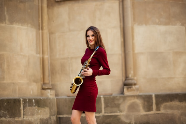 Sexy attractive woman with saxophone in ukraine, europe