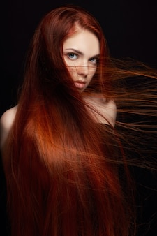 Sexy beautiful redhead girl with long hair
