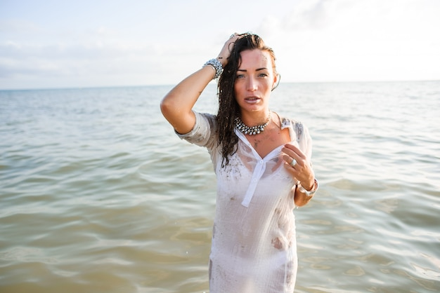 Sexy and beautiful woman is staying in sea