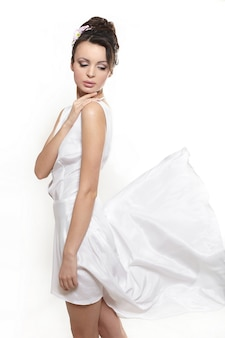 Sexy beautiful woman lady wearing white flying dress bride isolated on white