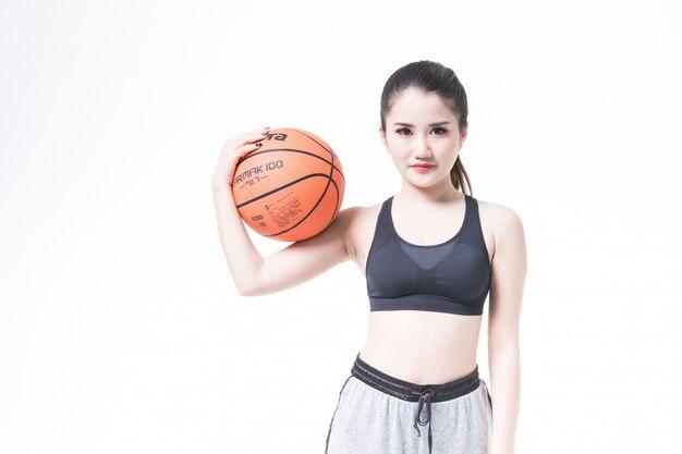 Sexy beauty playing basketball