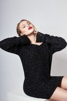 Sexy blonde girl in sweater vivid makeup