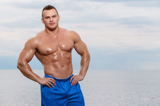 Sexy bodybuilder on the beach