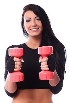 Sexy brunette with dumbbells