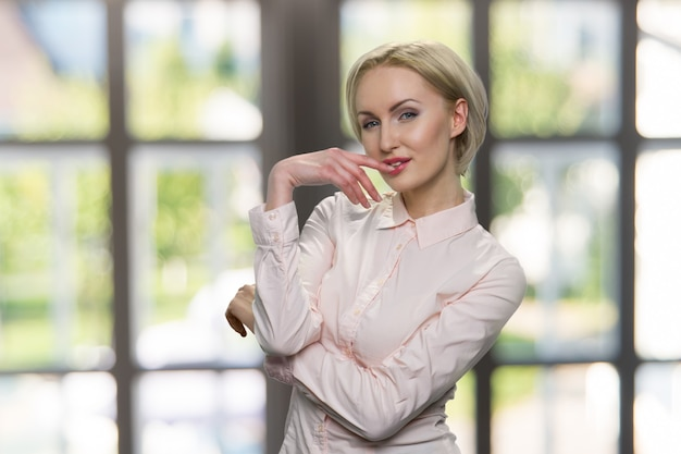 Sexy businesswoman in white blouse