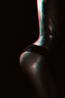 Sexy buttocks of a girl in panties with water drops on her body close-up. silhouette of a sporty slim female body