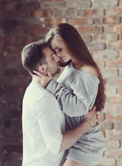 Sexy couple hugging passionately