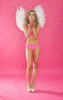 Sexy and cute angel blowing a kisses