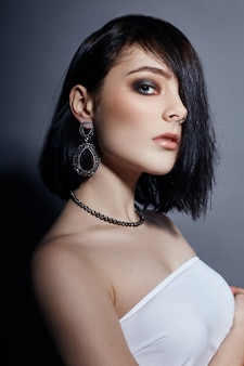 Sexy fashion brunette girl has black hair, jewels