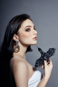 Sexy fashion brunette girl has black hair jewels