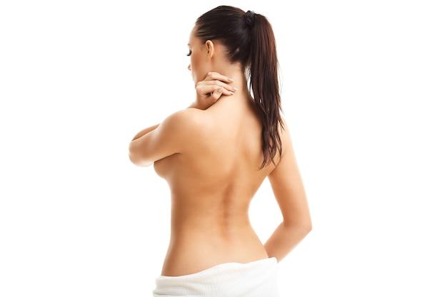 白で隔離されるセクシーなフィット裸の女性