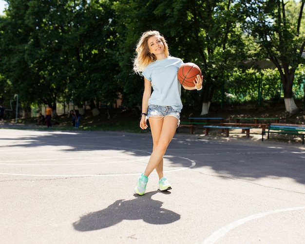 Sexy girl on the basketball court