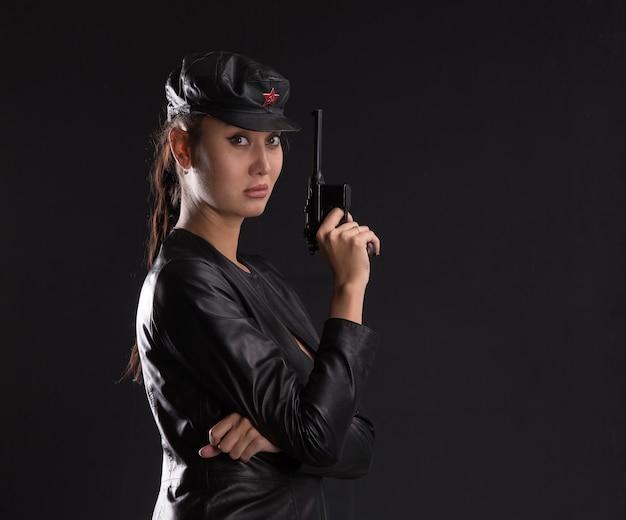Sexy girl killer brunette with a gun