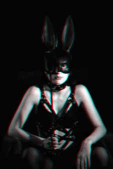 Sexy girl mistress masked bunny in erotic lingerie with glitch effect